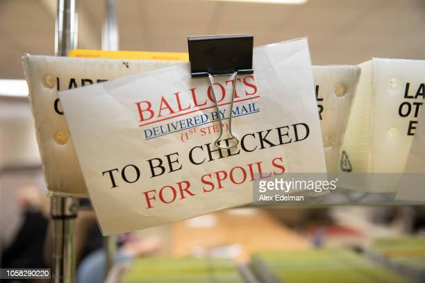 Mailed in ballots sit in US Postal Service bins inside the office of the Stanislaus County Clerk on November 6, 2018 in Modesto, California....