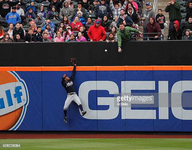 Mailex Smith of the Atlanta Braves cannot get to a two run home run hit by Lucas Duda of the New York Mets in the fifth inning during their game at...
