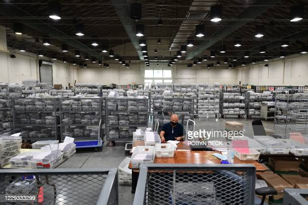 Mail-in ballots for the US presidential election await distribution to workers who will sort, examine and verify the ballots, at the Los Angeles...