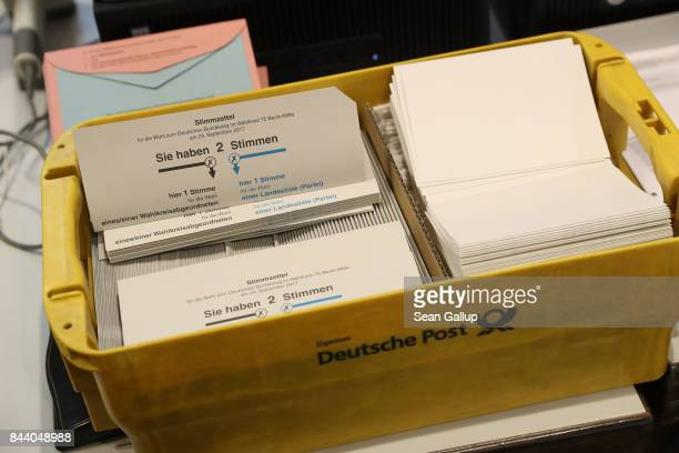 Mailin ballots lie in a box at a local voting bureau for early voting in German federal elections on September 8 2017 in Berlin Germany Voting is...