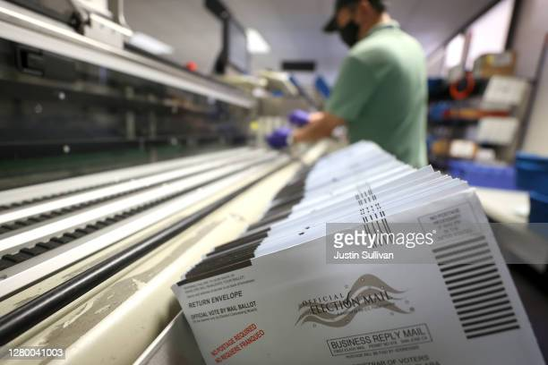 Mail-in ballots sit in a sorting machine at the Santa Clara County registrar of voters office on October 13, 2020 in San Jose, California. The Santa...