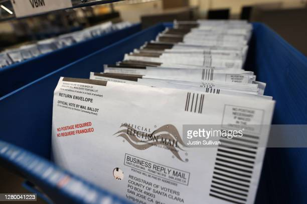 Mail-in ballots sit in trays before being sorted at the Santa Clara County registrar of voters office on October 13, 2020 in San Jose, California....