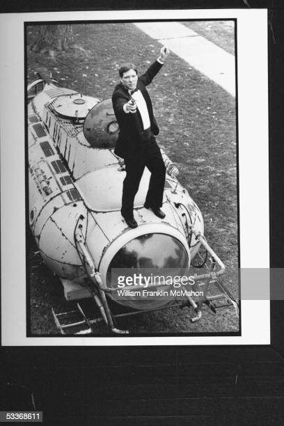 Mailman leading collector of James Bond memorabilia Doug Redenius in tuxedo standing on top of submarine 'Neptune' from film 'For Your Eyes Only' in...