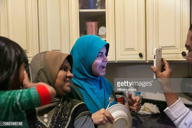 Maimunah and Aziza talk to their sister Jamila who is living in Japan over FaceTime on January 12 2019 in Chicago Illinois The Shukor family arrived...