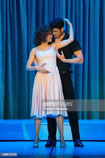 Main actors Anna Weihrauch and Mate Gyenei dance during the Rehearsal from 'Dirty Dancing' at Admiralspalast on April 24 2014 in Berlin Germany