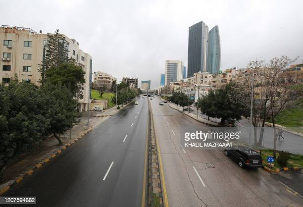 A main avenue is pictured empty on March 18 2020 in the Jordanian capital Amman as the country takes measures to fight the spread of the coronavirus...