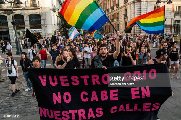 """Main banner of a demonstration for the International Day against Homophobia, Transphobia and Biphobia. Banner reads """"Your hate does not fit in our..."""