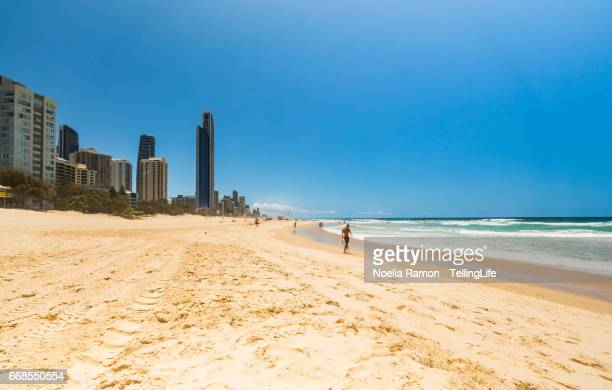Main beach Surfers Paradise, Gold Coast with someone walking on the beach