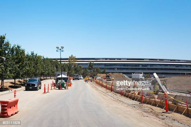 Main building and construction site at the Apple Park known colloquially as 'The Spaceship' the new headquarters of Apple Inc in the Silicon Valley...