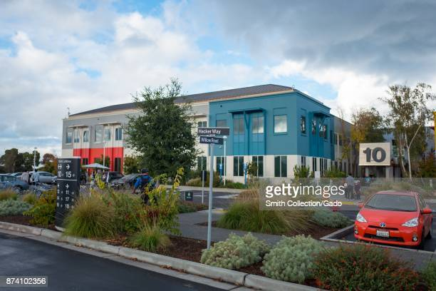 Main buildings are visible with sign for Hacker Way and Willow Road at the headquarters of social network company Facebook in Silicon Valley, Menlo...