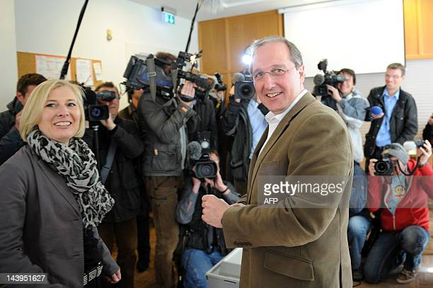 Main candidate for SchleswigHolstein's Christian Democrats Jost de Jager casts his vote with his wife Britta at a polling station in the northern...