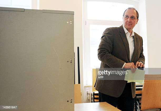 Main candidate for SchleswigHolstein's Christian Democrats Jost de Jager casts his vote at a polling station in the northern German town of...