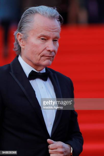 Main competition jury member American actor John Savage poses on the red carpet during the opening ceremony of the 40th Moscow International Film...