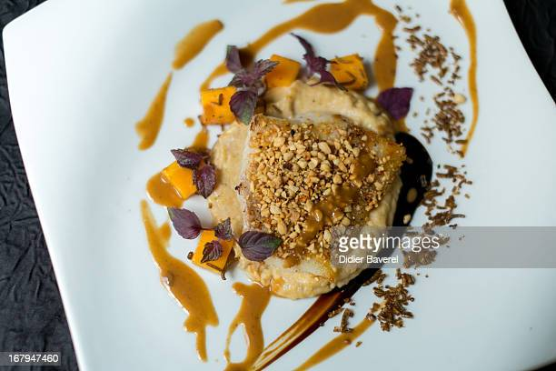A main course dish 'Dos de Cabillaud pane aux arachides poudre de vers de farine grille' 'Coated cod with toasted worms' prepared by French chef...