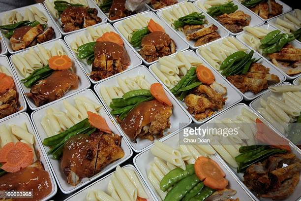 Main course dishes being prepared for airline passengers at Noi Bai Food Company Everyday the company processes about 2 tons of food for the airlines...