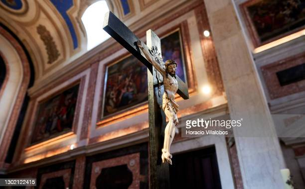 Main crucifix of Nossa Senhora da Purificação Parish Church before Sunday mass for video streaming during confinement due to the COVID-19 coronavirus...
