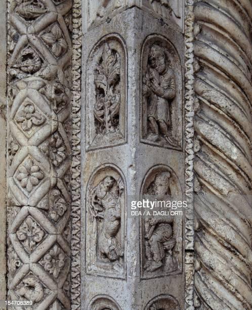 Main doorway, relief decoration of the facade St George the Martyr Basilica, Ferrara, Emilia-Romagna. Detail. Italy, 12th century.