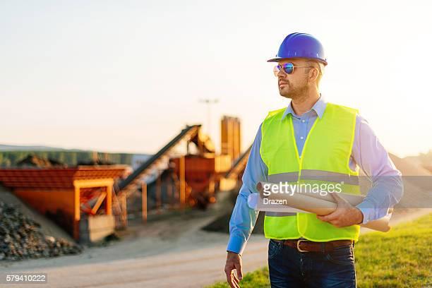 Main engineer with blueprints