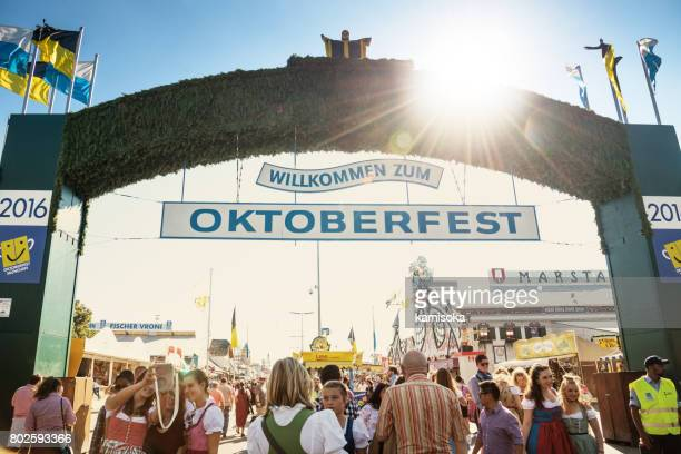 main entrance gate to oktoberfest fairground in munich, germany, 2016 - entrance sign stock photos and pictures