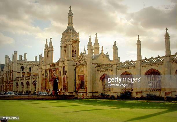 Main gate and entrance tower and walls of the King's College of the University of Cambridge a cloudy Summer day