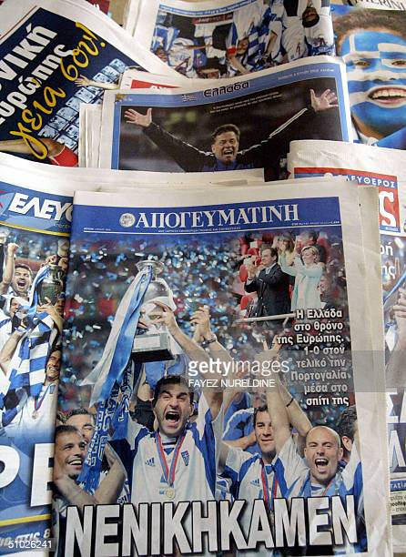 Main Greek newspapers and magazines frontpages show pictures of national football team's victory against Portugal in yesterday's Euro 2004 soccer...
