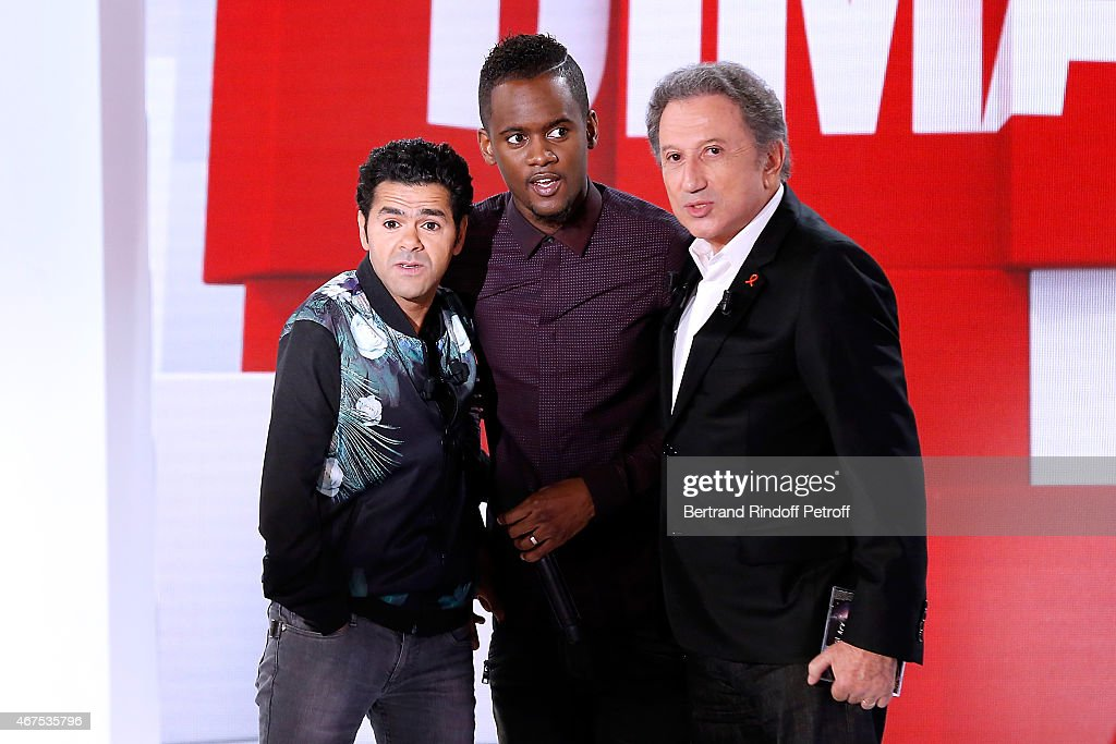 Main guest of the show Humorist Jamel Debbouze, Singer Black M and presenter of the show Michel Drucker attend the 'Vivement Dimanche' French TV Show at Pavillon Gabriel on March 25, 2015 in Paris, France.