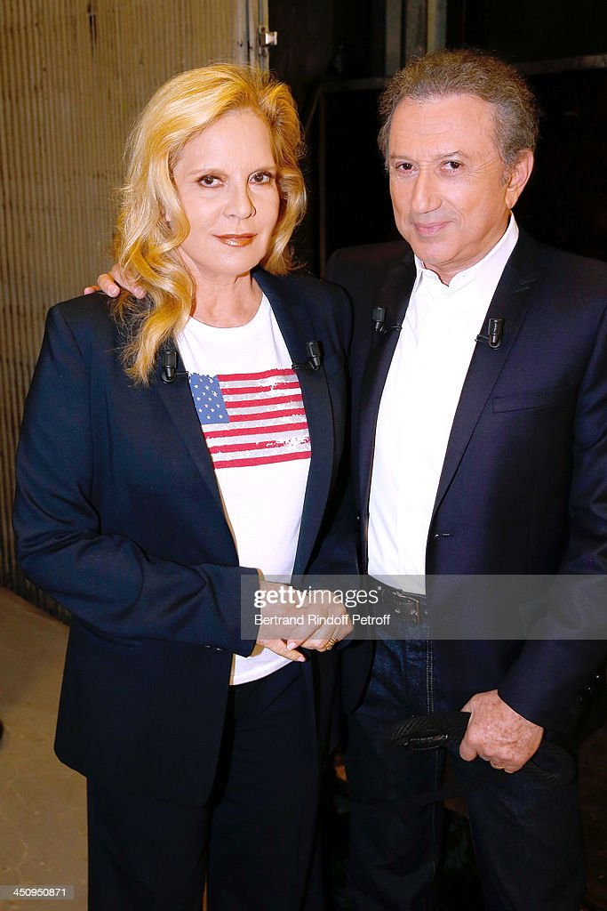 Main Guest, singer Sylvie Vartan and presenter of the show Michel Drucker attend the 'Vivement Dimanche' French TV Show, held at Pavillon Gabriel on November 20, 2013 in Paris, France.