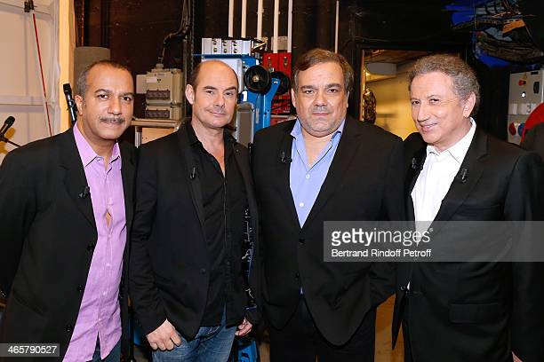 Main guests 'Les Inconnus' Pascal Legitimus Bernard Campan and Didier Bourdon pose with presenter of the show Michel Drucker attend the 'Vivement...