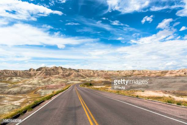 main highway through badlands national park in south dakota, usa - south dakota stock pictures, royalty-free photos & images