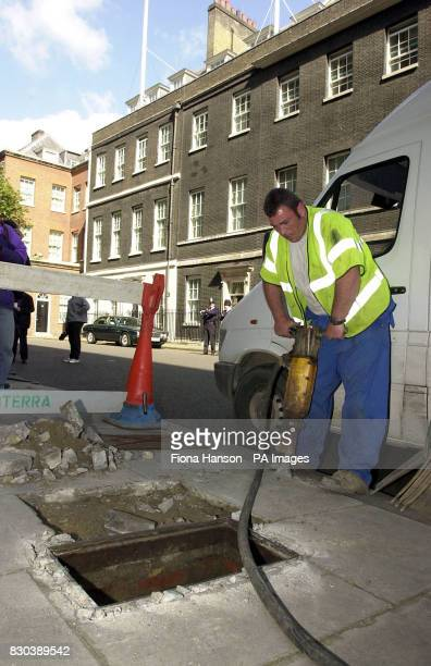 Main layer Chris Southam drills in Downing Street before replacing a fire hydrant It was speculated whether the noise would disturb the Prime...