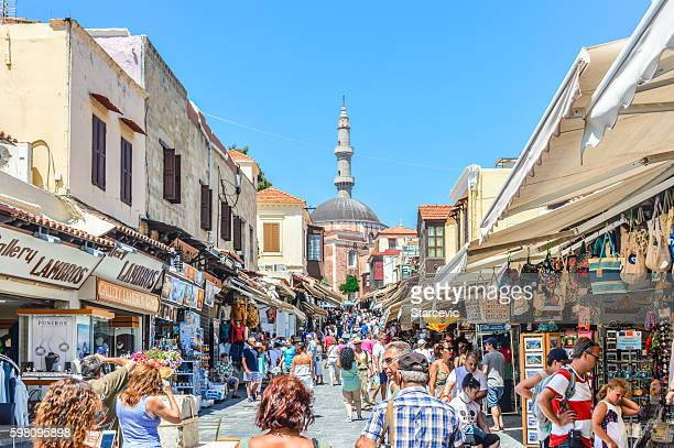 main market street in rhodes, greece - rhodes dodecanese islands stock photos and pictures