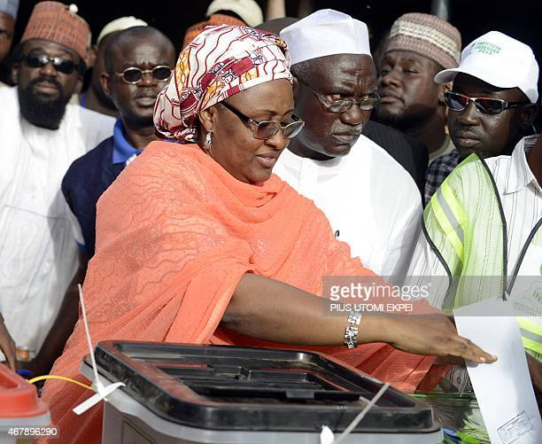 Main opposition All Progressives Congress presidential candidate Mohammadu Buhari's wife Aisha casts her ballot at a polling station in the Gidan...