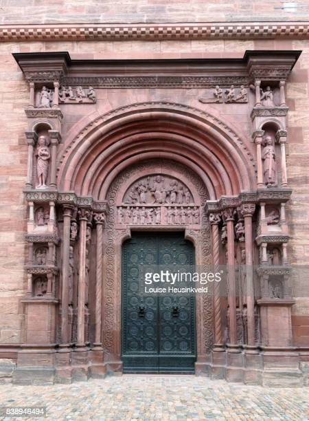 main porch, basel minster, switzerland - minster stock photos and pictures