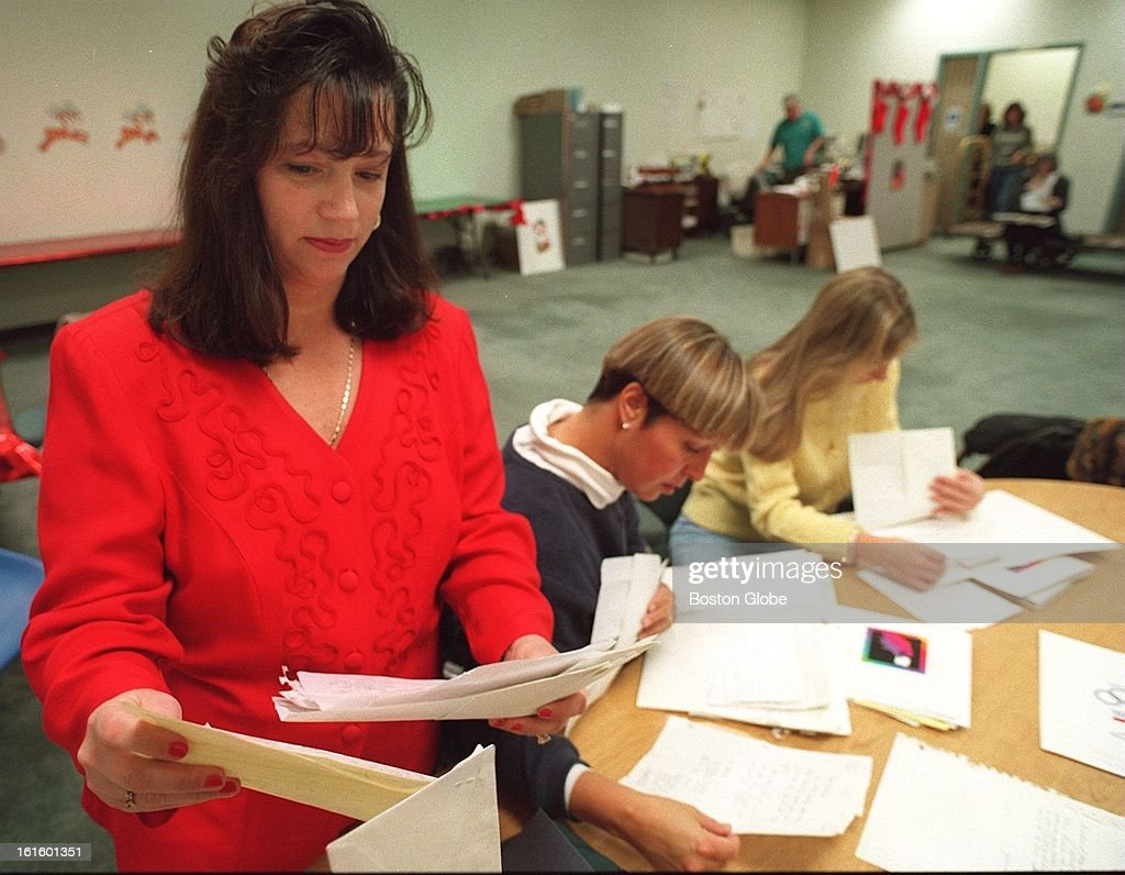 Letters to santa pictures getty images theresa diecidue a volunteer with some of the letters spiritdancerdesigns Images