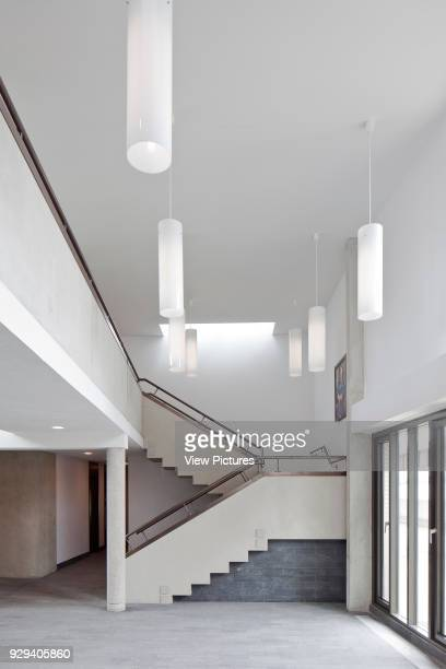 Main reception with lights and staircase Wolfson College Auditorium Oxford United Kingdom Architect Berman Guedes Stretton 2013