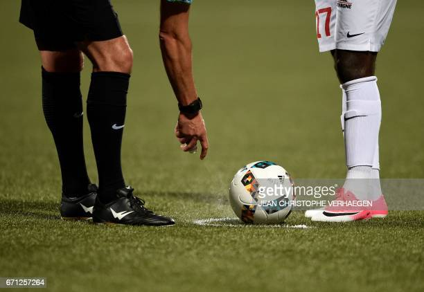Main referee Nicolas Rainville uses his spray during the French L1 football match between Nancy and Marseille on April 21, 2017 at Marcel Picot...