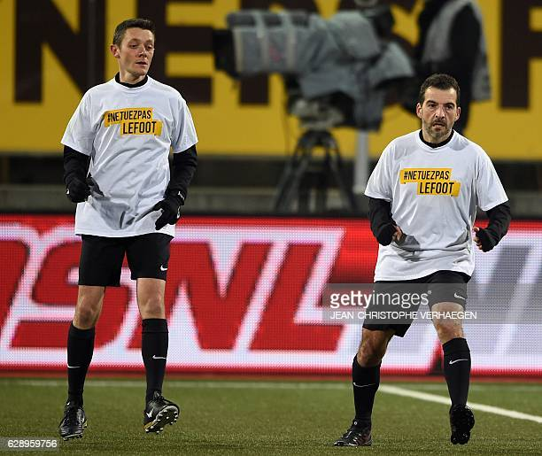 Main referee Sébastien Desiage and Line referee Gilles Lang wear a tshirt reading 'Don't kill soccer' ahead of the French L1 football match between...
