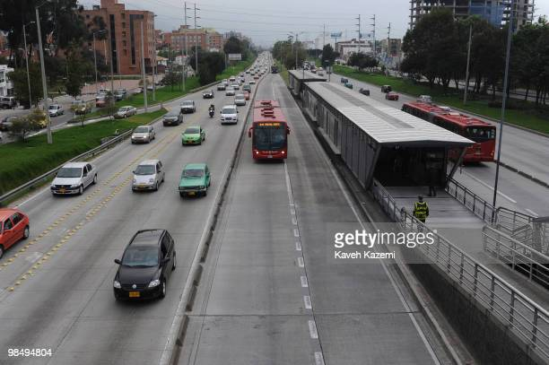 A main road with Transmilenia buses running in both directions of the city Bogota formerly called Santa Fe de Bogota is the capital city of Colombia...