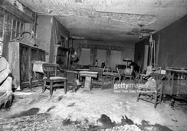 Main room of Edith Bouvier Beale at West End Road in East Hampton LI is filled with dusty furniture and much of ceiling plaster has fallen