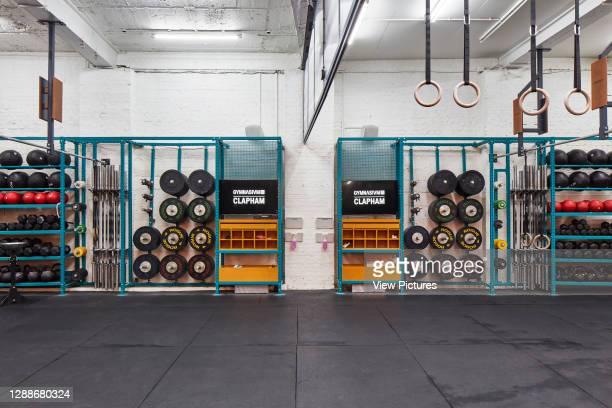 Main room with weights. Gymnasium Clapham, London, United Kingdom. Architect: Holland Harvey Architects, 2019.