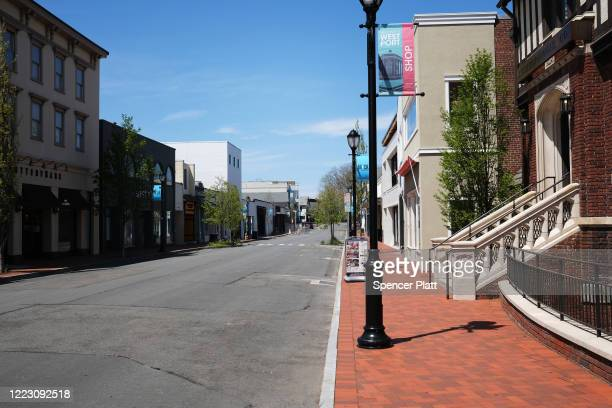 A main shopping street of closed stores in this affluent community remains mostly empty of pedestrians on May 05 2020 in Westport Connecticut A...