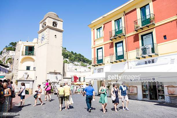 main square of capri with people - capri stock pictures, royalty-free photos & images