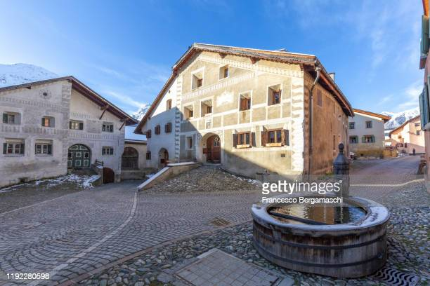 main square of the alpine village. - guarda switzerland stock pictures, royalty-free photos & images