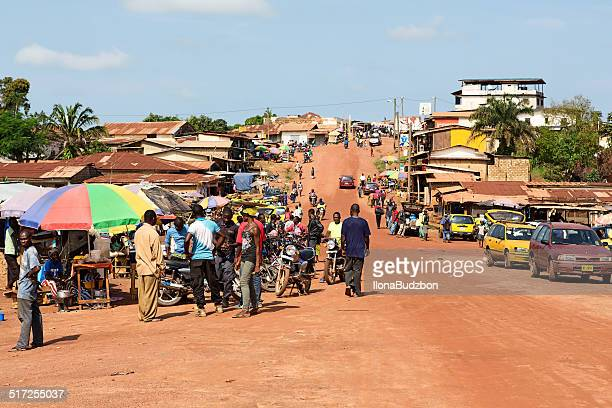 main street and urban marketplace in gbarnga in liberia. - monrovia liberia stock photos and pictures