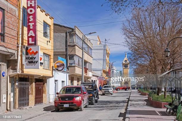 Main street and yellow clock tower in the city Uyuni, Antonio Quijarro Province, Potosí Department, Bolivia.
