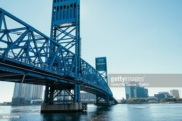 Main Street Bridge Over River Against Clear Sky In City