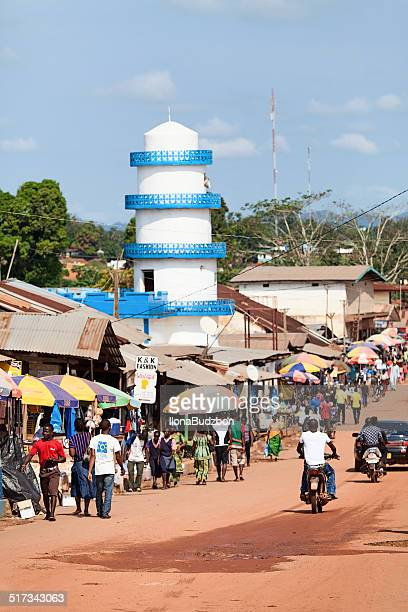main street in african city. - monrovia liberia stock photos and pictures