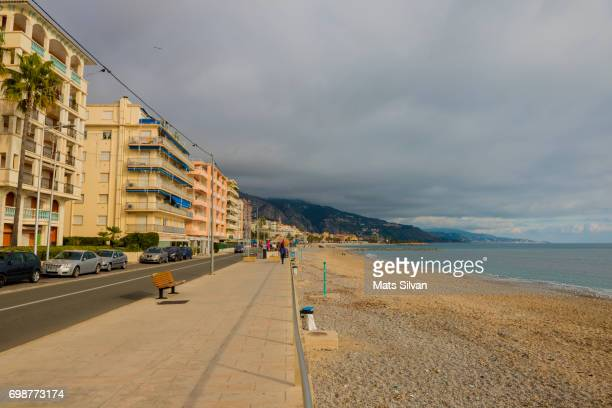 Main Street In Menton And The Beach With Overcast Clouds