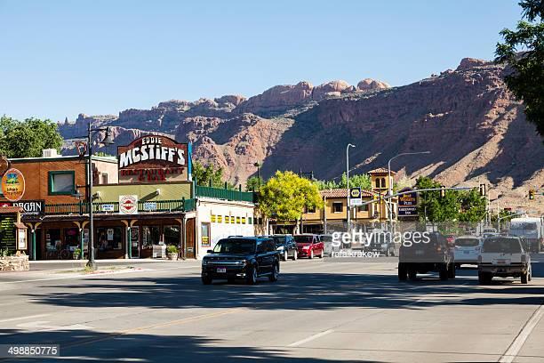 main street in moab utah - moab utah stock photos and pictures