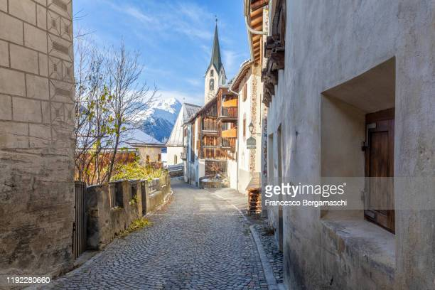 main street in the traditional alpine village. - guarda switzerland stock pictures, royalty-free photos & images